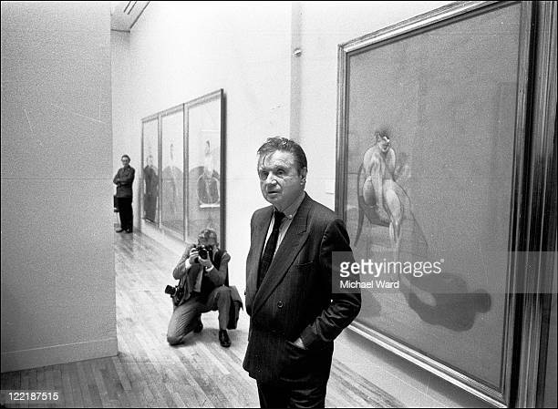 Artist Francis Bacon in front of the left panel of his 'Triptych' at his Tate Gallery show 1985