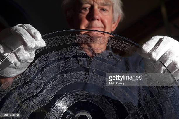 Artist Frank Grenier looks at the crystal glass dish which he has engraved with a recreation of the Bayeux Tapestry on October 1 2012 in Glastonbury...