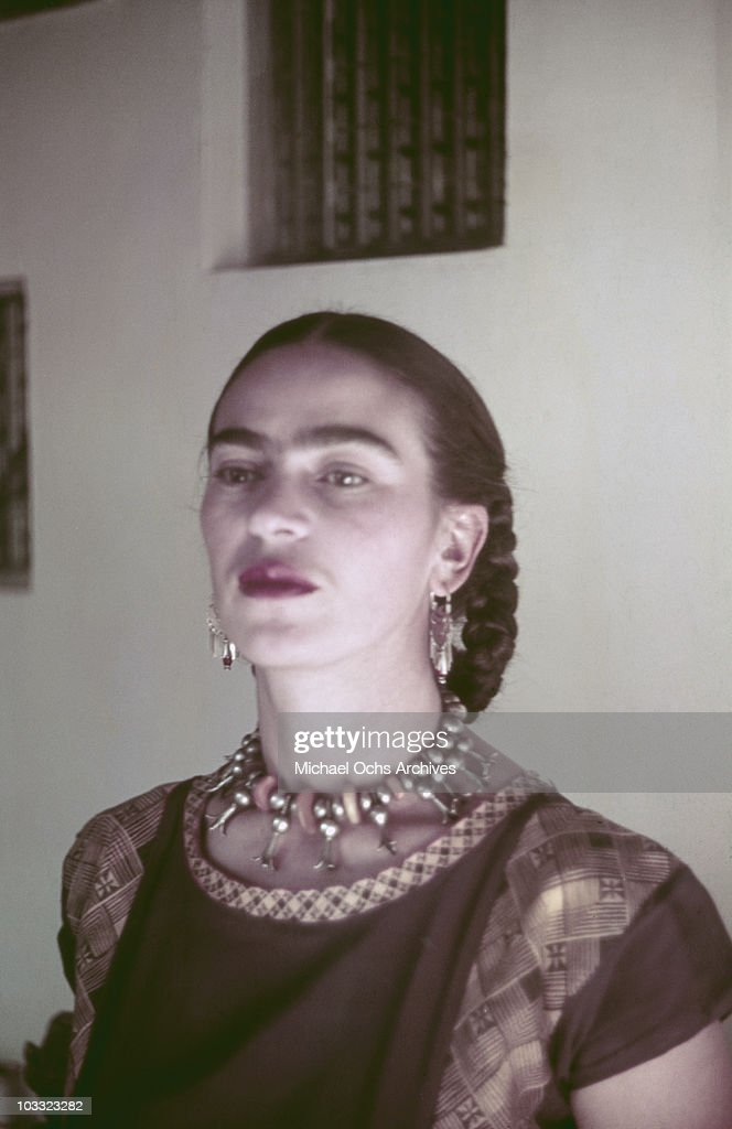 Artist Frida Kahlo poses for a portrait at the home and studio she shares with her husband Diego Rivera, designed by architect Juan O'Gorman circa 1940 in the Colonia San Angel neighborhood of Mexico City, Mexico.