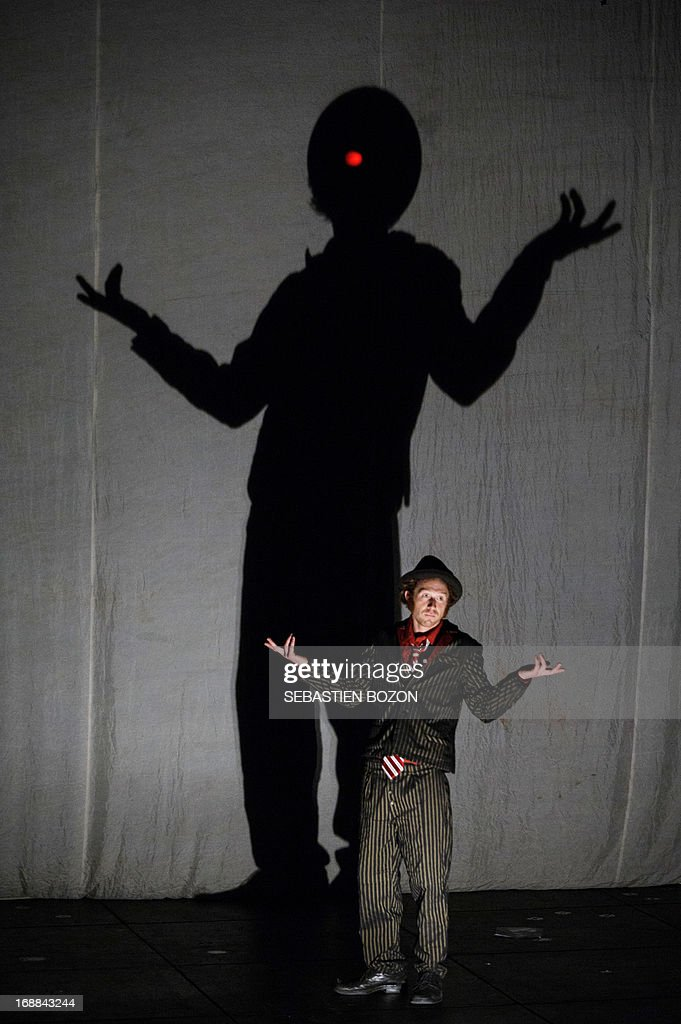 Artist from 'Le cirque Plume' company performs during the rehearsal of 'Tempus Fugit ?' show on May 15, 2013 in Besançon, eastern France. AFP PHOTO / SEBASTIEN BOZON