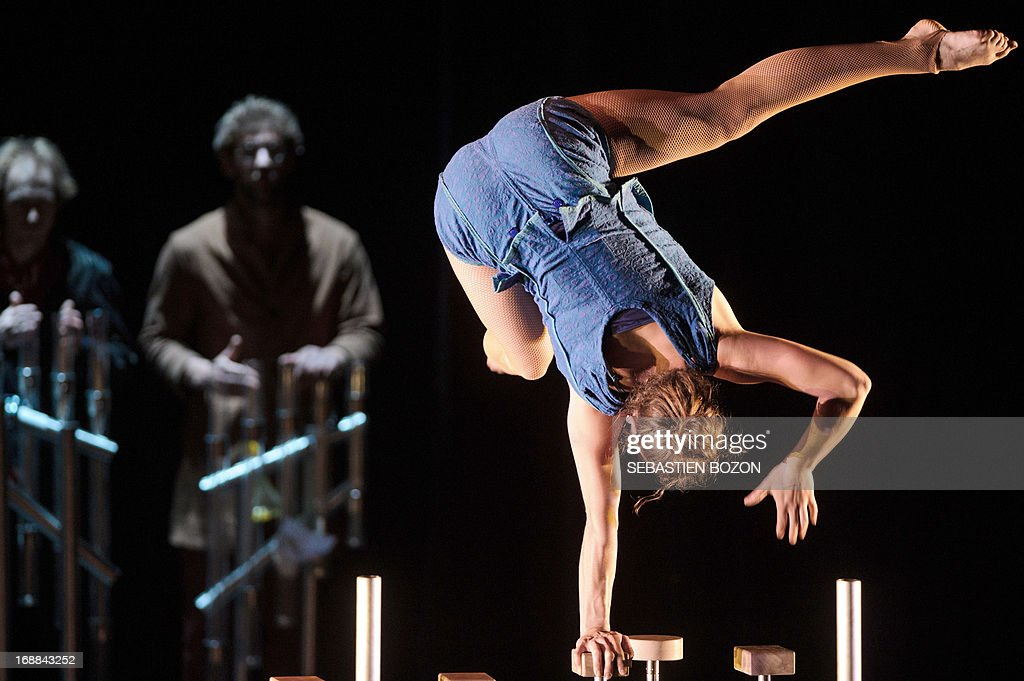 Artist from 'Le cirque Plume' company performs during the rehearsal of 'Tempus Fugit ?' show on May 15, 2013 in Besançon, eastern France.