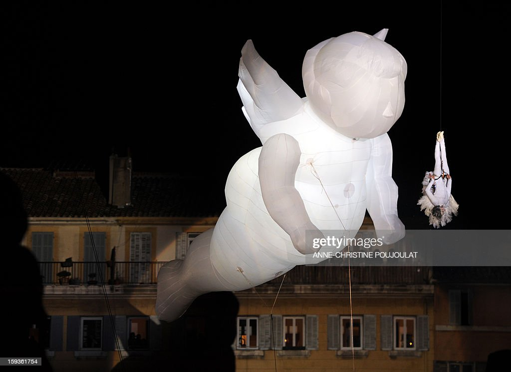 Artist from Studio de Cirque' Company performs in the sky during 'Place des Anges' at the Cours d'Estienne d'Orves in Marseille on January 12, 2013 in Marseille, one of the events marking the launching of festivities for the Marseille-Provence 2013 European Capital of Culture. The event marks the start of a year, leading to a cultural renaissance in France's second-largest metropolitan area.