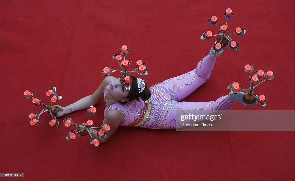 Artist from Twenty six member China Jilin Provincial Art troupe from Republic of China performs at Rabindra Bharati University on March 1, 2013 in Kolkata, India. The event mark the spring festival & Chinese New year.