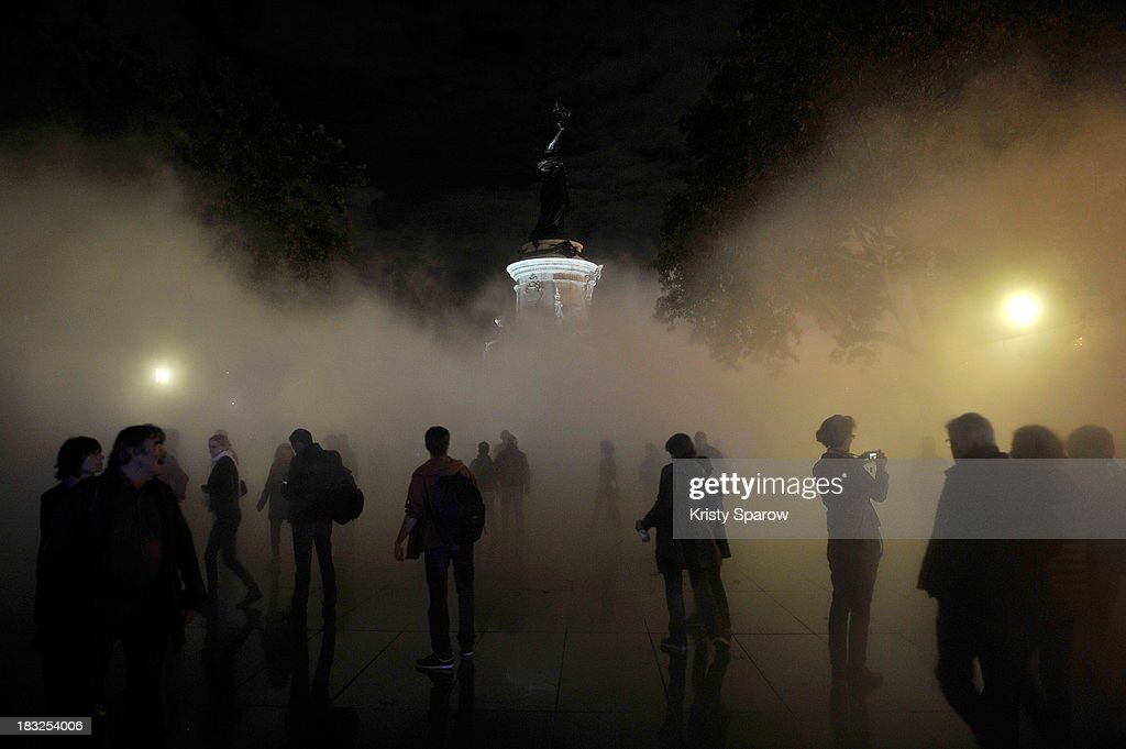 Artist Fujiko Nakaya combines art, science and technology to create 'Fog Square' during Nuit Blanche in Place de la Republique on October 5, 2013 in Paris, France.