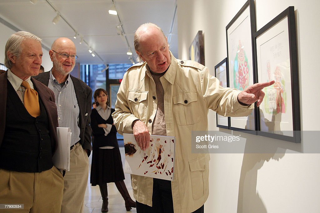 Artist Gahan Wilson (C) discusses his piece on display during a press preview of the Metropolitan Opera's and The New Yorker's exhibition of 'Hansel and Gretel' at the Arnold & Marie Schwartz Gallery Met on November 15, 2007 in New York City.