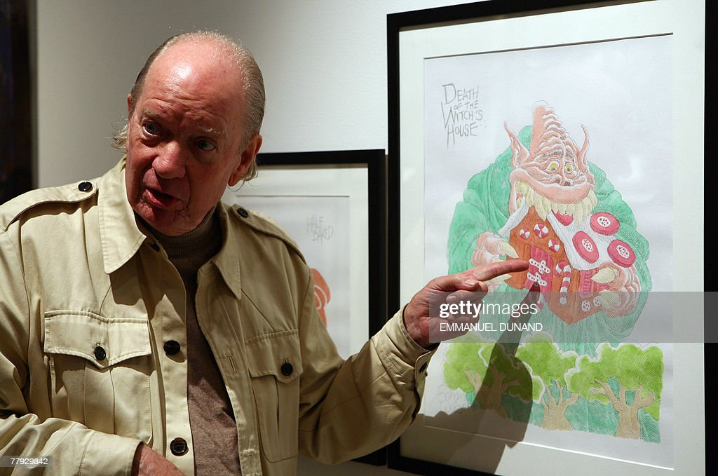 Artist Gahan Wilson points at one of his works 'Hansel and Gretel Triptych' on display at an exhibition by New Yorker magazine artists inspired by the Grimm Brothers fairy tale 'Hansel and Gretel' at the Metropolitan Opera Gallery in New York, 15 November 2007. The exhibition 'Hansel and Gretel' was inspired by the Metropolitan Opera's holliday presentation of Engelbert Humperdinck 's operatic version of the Grimm fairy tale schedule to open 24 December 2007. AFP PHOTO/Emmanuel DUNAND