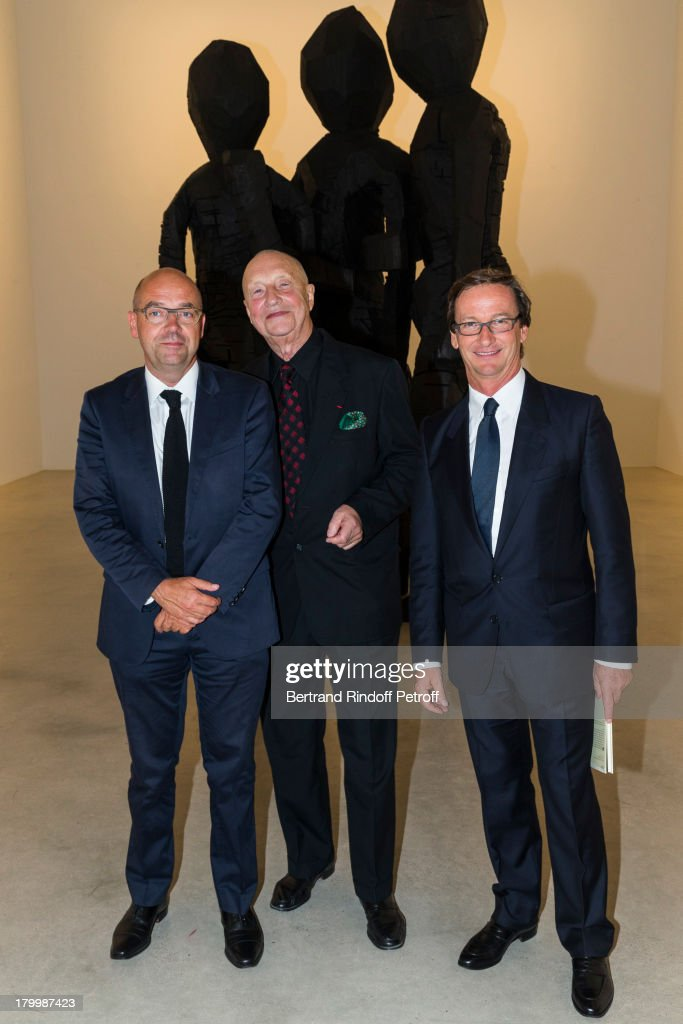 Artist Georg Baselitz (C), galerist Thaddaeus Ropac (R) and Director of the Paris Museum of Modern Art, Fabrice Hergott, pose in front of Baselitz' monumental bronze sculpture 'BDM Gruppe' during the Georg Baselitz exhibition preview and dinner at Thaddeus Ropac Gallery on September 7, 2013 in Pantin, east of Paris, France. The exhibition opens on September 8.