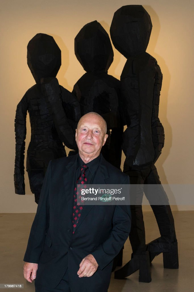 Artist Georg Baselitz poses in front of his monumental bronze sculpture 'BDM Gruppe' during the Georg Baselitz exhibition preview and dinner at Thaddeus Ropac Gallery on September 7, 2013 in Pantin, east of Paris, France. The exhibition opens on September 8.
