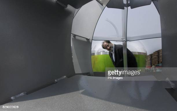Artist Gerry Judah inspects one of his installations outside West India Quay East London The three dimentional artist has installed seven 8ft tall...