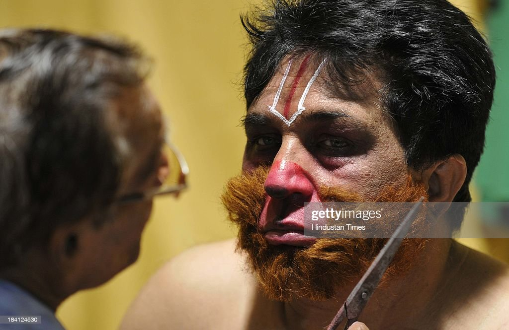 Artist getting ready before performance of Ramlila at Subhash Maidan on October 11, 2013 in New Delhi, India. Ramlila is a dramatic folk re-enactment of the life of Hindu Lord Rama's victory after a ten day battle with the ten headed Demon King Ravana.
