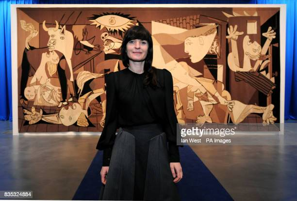 Artist Goshka Macuga with her tapestry inspired by Picasso's Guernica at the newly reopened Whitechapel Art Gallery in London during a media preview...