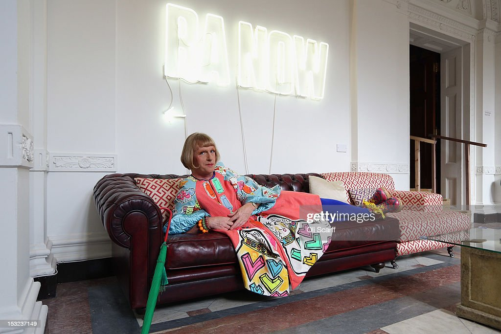 Artist Grayson Perry poses in the 'RA Now' exhibition at the Royal Academy on October 2 2012 in London England The RA Now exhibition features works...