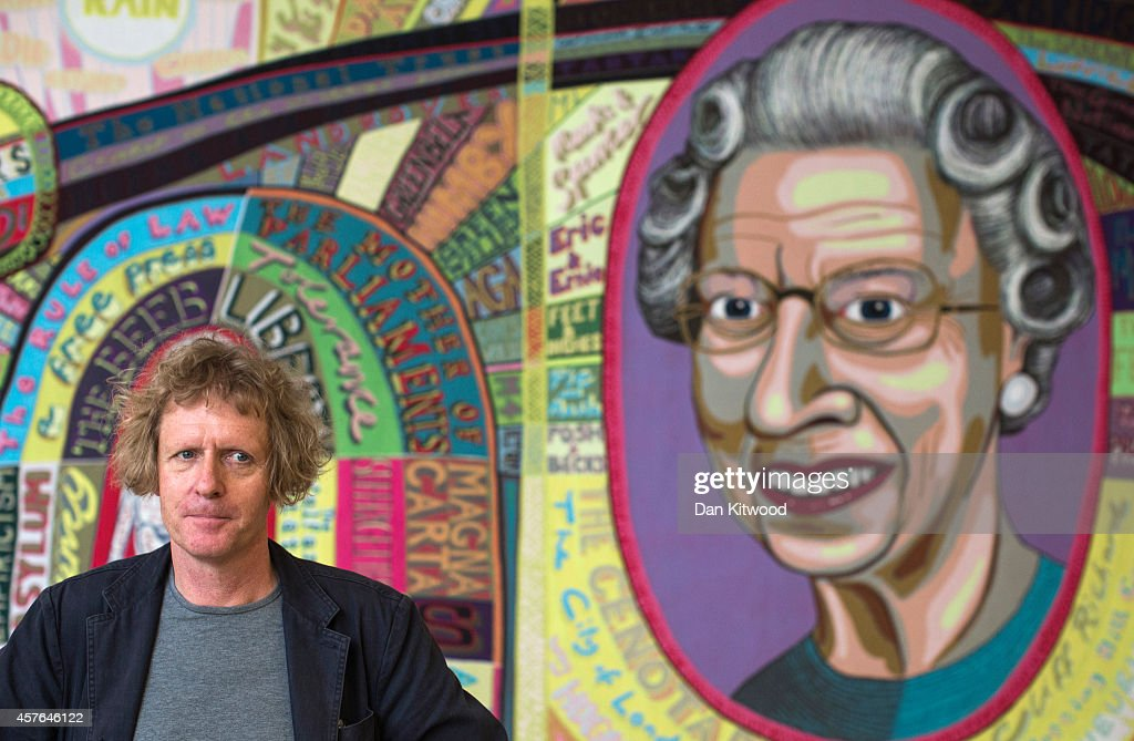 Artist Grayson Perry stands in front of a piece of his entitled 'Comfort Blanket' during a photocall for his 'Who Are You' exhibition at the National...