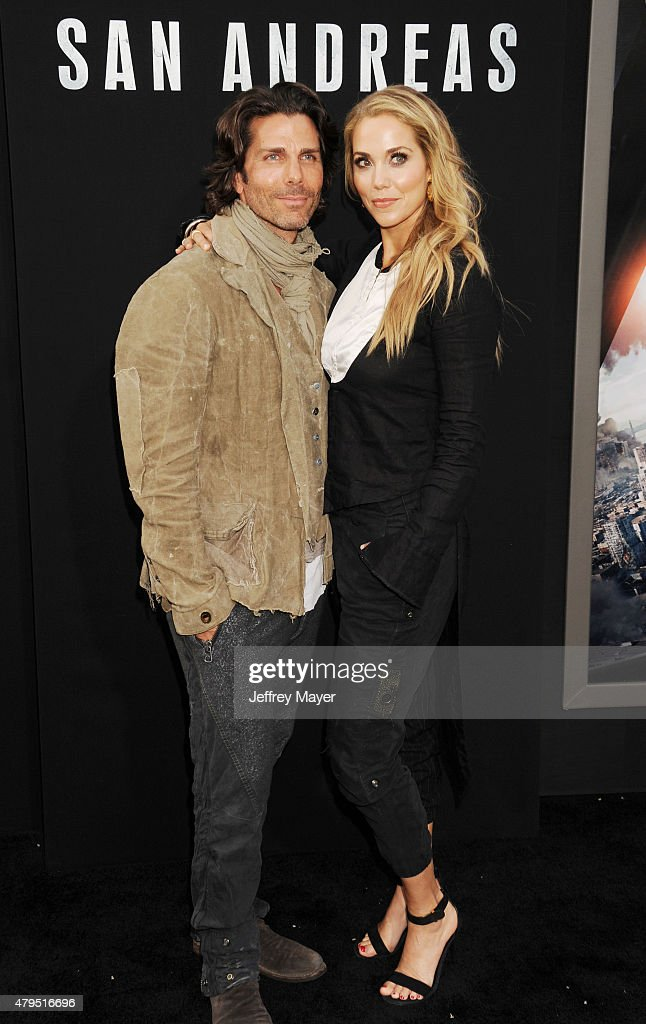 Artist Greg Lauren and actress Elizabeth Berkley arrive at the 'San Andreas' Los Angeles Premiere at TCL Chinese Theatre IMAX on May 26 2015 in...