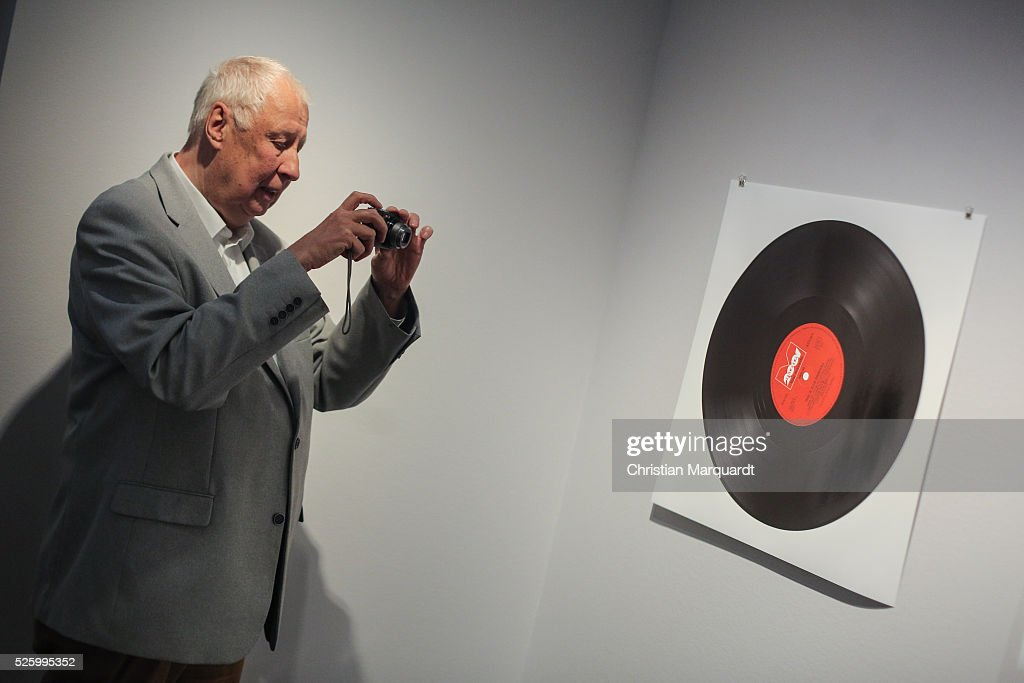 Artist Hans-Peter Feldmann takes a picture of his work during the preview of the exhibitions 'Hans-Peter Feldmann - retrospective' and 'Talents 37 - Borrowed Light by Bianca Pedrina' at Amerika Haus on April 29, 2016 in Berlin, Germany. On the occasion of the 75th birthday of Hans-Peter Feldmann presents C / O Berlin, a retrospective with about 250 pictures from the late 1960s to the most recent works. The exhibition opens to the public on April 30 and runs until July 10, 2016.