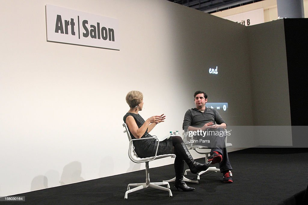 Artist Hernan Bas (R) speaks onstage with Bonnie Clearwater (L), Director and Chief Curator of Museum of Contemporary Art in North Miami, during Art Salon at Art Basel Miami Beach 2012 at the Miami Beach Convention Center on December 9, 2012 in Miami Beach, Florida.