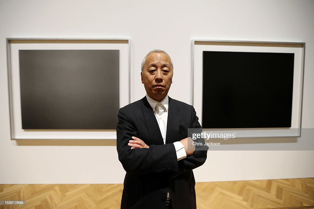 Artist <a gi-track='captionPersonalityLinkClicked' href=/galleries/search?phrase=Hiroshi+Sugimoto&family=editorial&specificpeople=4394679 ng-click='$event.stopPropagation()'>Hiroshi Sugimoto</a> poses in front of his photgraphs at the launch of Pace London at 6 Burlington Gardens - the Royal Academy on October 3, 2012 in London, England. Opening the space is Rothko/Sugimoto: Dark Paintings and Seascapes, which will run until November 16th 2012.