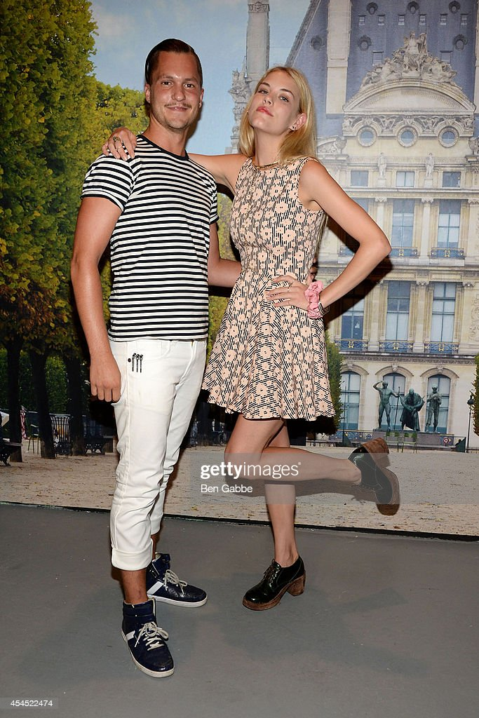 Artist Ian Sklarsky (L) and model Ashley Smith attend the Maison Jules Presentation during Mercedes-Benz Fashion Week Spring 2015 at Art Beam on September 2, 2014 in New York City.