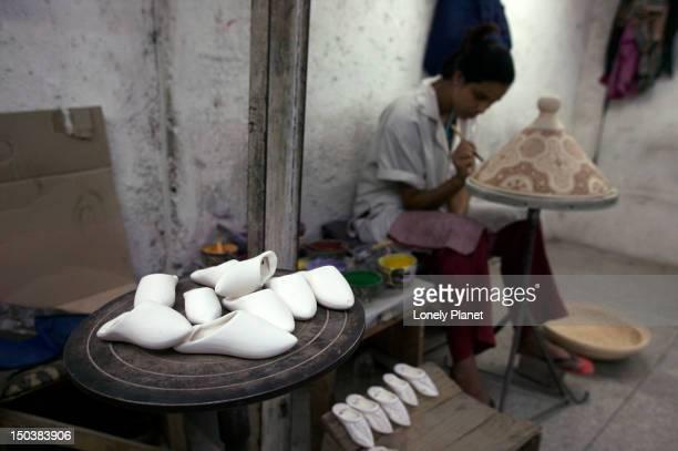 Artist in Ceramics factory.