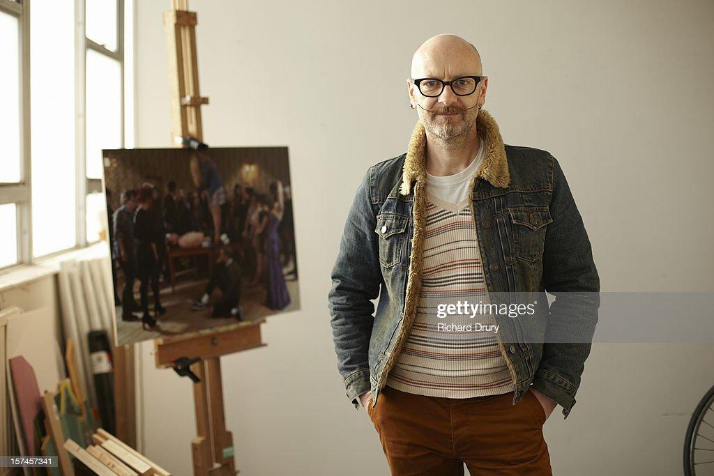 Artist in his studio : Stock Photo