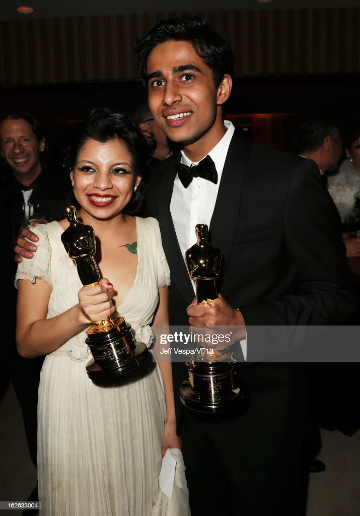 Artist Inocente Izucar (L) and actor Suraj Sharma attend the 2013 Vanity Fair Oscar Party hosted by Graydon Carter at Sunset Tower on February 24, 2013 in West Hollywood, California.