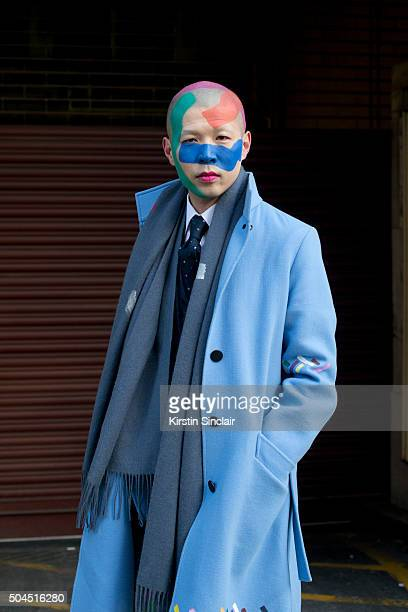 Artist Itu wears a customized Louis Vuitton coat tailormade jacket and own design scarf on day 3 of London Collections Men on Januay 10 2016 in...