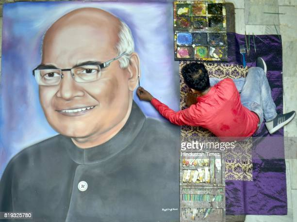 Artist Jagjot Singh Rubal touches up his painting of the newly elected President of India Ram Nath Kovind at his home on July 20 2017 in Amritsar...
