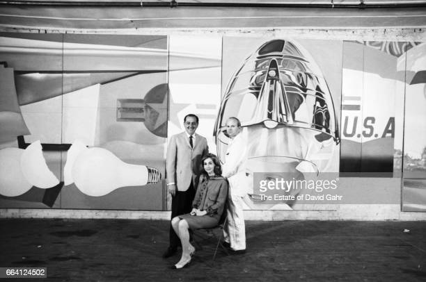 Artist James Rosenquist and art collectors Bob and Ethel Scull pose for a portrait at the Leo Castelli Gallery where Rosenquist is completing...