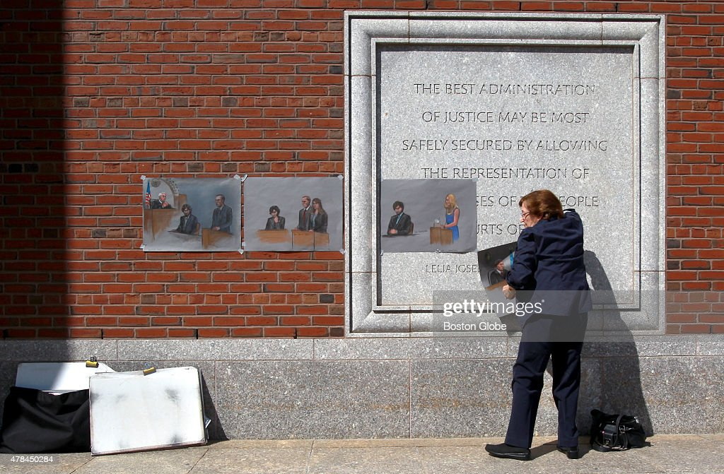 Artist Jane Flavell Collins pulls down her courtroom sketches outside the Moakley federal courthouse in Boston Mass after the sentencing of convicted...