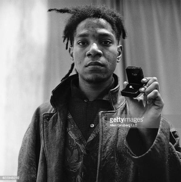 Artist JeanMichel Basquiat Holding Engagement Ring