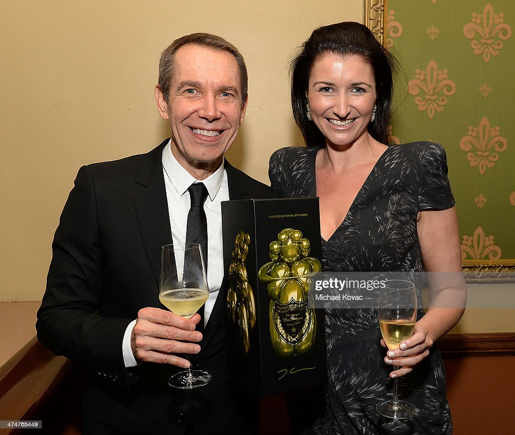 Artist Jeff Koons (L) and Dom Perignon's Julia Fitzroy attend the Dom Perignon Reception after The Un-Private Collection: Jeff Koons and John Waters in Conversation at Orpheum Theatre on February 24, 2014 in Los Angeles, California.