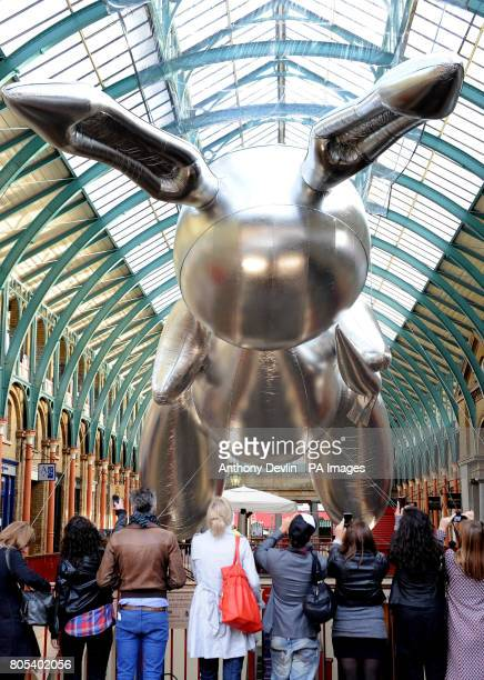 Artist Jeff Koons' giant 53 foot rabbit balloon is exhibited in Covent Garden Market to publicise Pop Life Art in a Material World at Tate Modern...