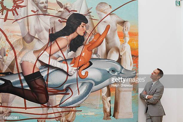 Artist Jeff Koons poses in front of his art work 'Antiquity 3 2011' during the opening of the exhibition 'Jeff Koons The Painter The Sculptor' at the...