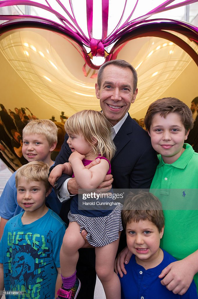 Artist Jeff Koons poses with his children during the 'Jeff Koons' exhibition preview at the Fondation Beyeler on May 11, 2012 in Basel, Switzerland. The exhibition devoted to the American artist will be on display from May 13 until September 2, 2012.