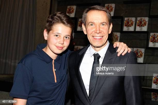 Artist Jeff Koons poses with son Sean Koons at Jeff Koons A Retrospective at The Whitney Museum of American Art on June 24 2014 in New York City