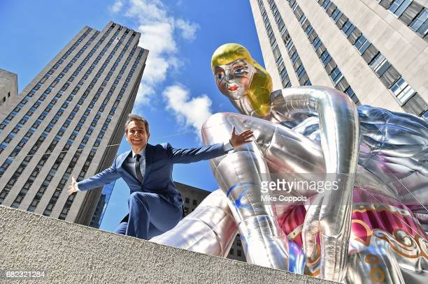 Artist Jeff Koons unveils seated ballerina inflatable sculpture at Rockefeller Center on May 12 2017 in New York City