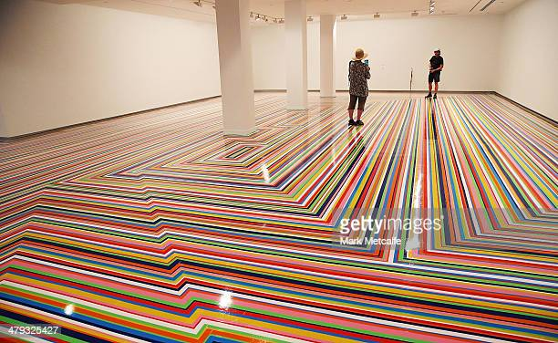 Artist Jim Lambie's 'Zobop' floor work is displayed during a media preview as part of the 19th Beinnale of Sydney at the Museum of Contemporary Art...