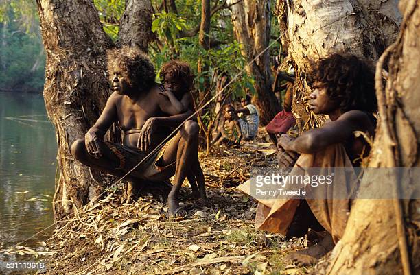 Artist Jimmy Njiminjuma and his family at Mukkamukka his mother's country Jimmy paints Rainbow Serpent that lives in this billabong central Arnhem...
