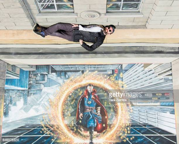 Artist Joe Hill of 3D Joe and Max poses with his lifesize 3D painting celebrating the arrival of Marvel Studios' 'Doctor Strange' on BluRay at Best...