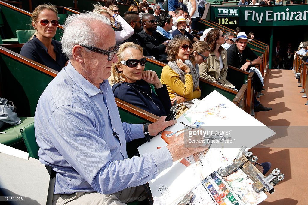 Artist Joel Blanc draws French Tennis player Gilles Simon during his match in the 2015 Roland Garros French Tennis Open - Day 2, on May 25, 2015 in Paris, France.