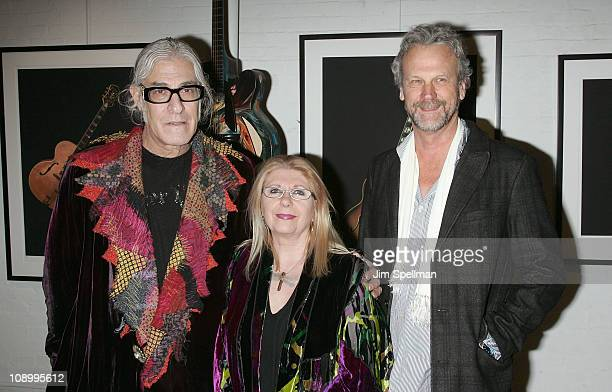 Artist Jonathan Singer artist Annie Haslam and Morrison Hotel Gallery owner Peter Blachley attend 'The Art of the Guitar Photography of Jonathan...