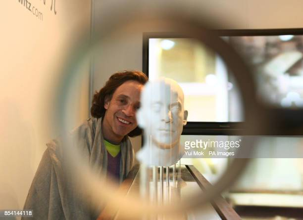 Artist Jonty Hurwitz next to his sculpture 'The Hurwitz Singularity' at the launch of his series of anamorphic sculptures Generation Pi during the...