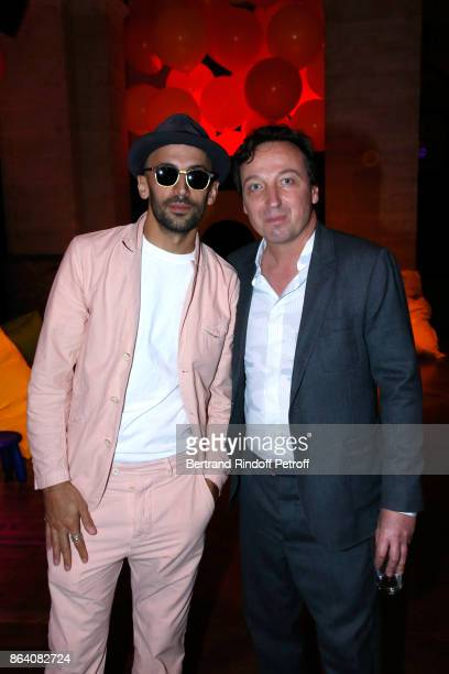 Artist JR and Emmanuel Perrotin attend the 'Bal Jaune Elastique 2017' Dinner Party at Palais Brongniart during FIAC on October 20 2017 in Paris France