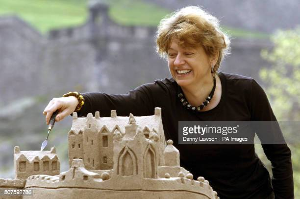Artist Kate Robinson with her sand sculpture on Castle Street in Edinburgh it contains 100 flight tickets and depicts Gaudi cathedral and Edinburgh...