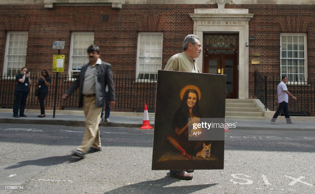 Artist Kaya Mar carries his painting portraying the Duchess of Cambridge with her newly born child and a corgi past the Lindo wing of St Mary's Hospital in London on July 5, 2013. Prince William and his wife Catherine's baby, which will be third in line to the throne, will be born in the private Lindo wing of St Mary's Hospital, where William was born in 1982 and his brother Harry in 1984.