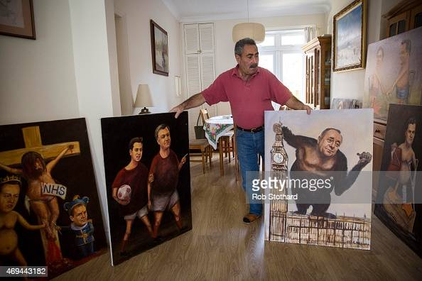 Artist Kaya Mar presents his latest political paintings at his home in Ealing on April 6 2015 in London England Originally a landscape and portrait...
