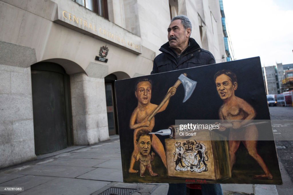Artist Kaya Mar stands with his painting depicting David Cameron, Ed Miliband and Nick Clegg challenging press freedom, outside the Old Bailey on February 19, 2014 in London, England. Downing Street's former director of communications and News Of The World editor Andy Coulson and the former News International chief executive Rebekah Brooks, along with six others, face a series of charges linked to the phone hacking of celebrities and others at the now-defunct newspaper.