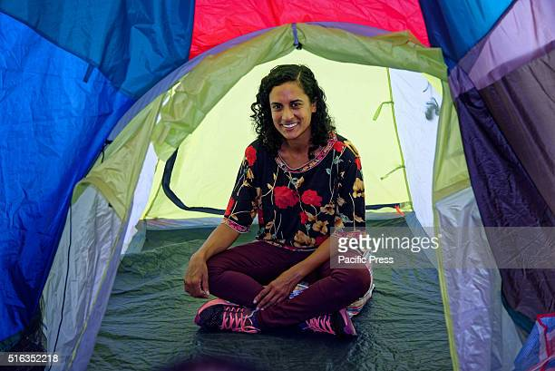 ISLAND SYDNEY NSW AUSTRALIA Artist Keg de Souza poses inside 'We Built this City' an embroidered inflatable architecture during the media preview for...