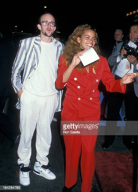 Artist Keith Haring and guest attend the Junior Division of the Princess Grace FoundationUSA Benefit on May 10 1988 at the Hard Rock Cafe in New York...
