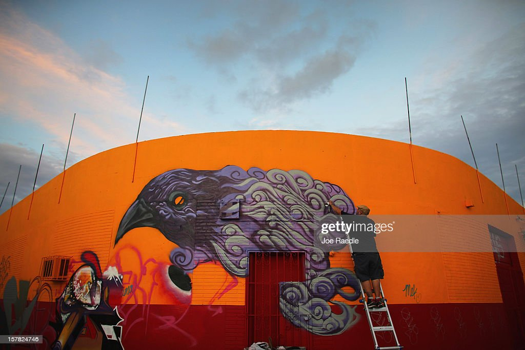 Artist known as Czrprz paints a raven on the wall of a building as he participates in the Wynwood Walls art project on December 6, 2012 in Miami, Florida. The art project along with many other satellite shows around the city coincide with the International art show, 'Art Basel', which runs until the 9th of December.